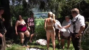 Pierced and inked mature group sex on the nature