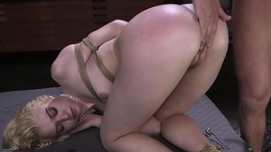 Raw bondage accompanied by girl
