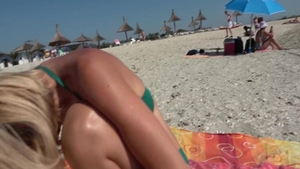 Wet pussy british mature bends over at the beach
