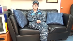 Crying with amateur wearing military on the couch